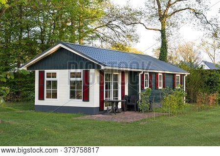 Colroful Wooden Holiday Home At A Campsite In The Netherlands