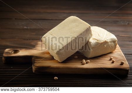 Soybean Tofu Vegetable Bean Curd On Cutting Board On Kitchen Table
