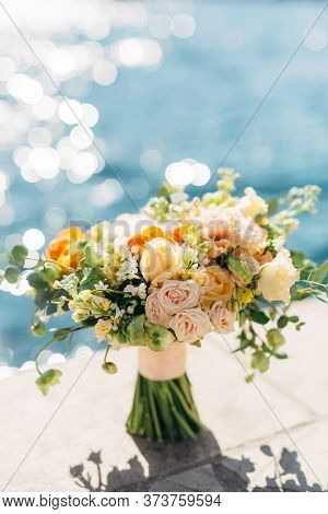 Bridal Bouquet Of Cream Roses, Eucalyptus Tree Branches, Yellow And Orange Buttercups, Not Blooming