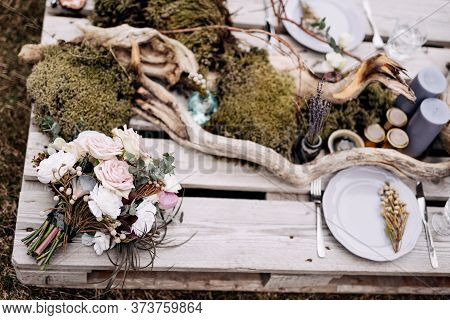 Bridal Bouquet Of White Roses, Brunia And Leucadendron , Bouquet Of Dried Lavender On The Romantic O