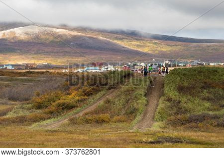 Nome, Alaska, Usa - September 10th, 2019: Local Kids Playing On A Dirt Road In Nome, Alaska.