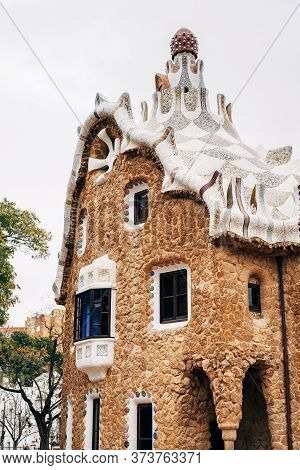 The Central Entrance To The Park Guell In Barcelona. Gingerbread Houses. Left-handed, Guardhouse.