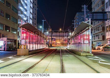 Hiroshima, Japan - September 30, 2019: The Tram Ujinanichome Station On Ujina-dori Ave At Night In H