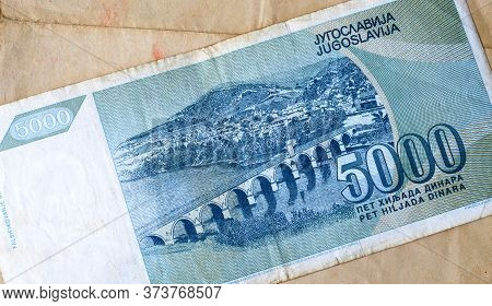 Obverse Of 5.000 Dinars Paper Bill Issued By Yugoslavia, That Shows Old Stone Bridge