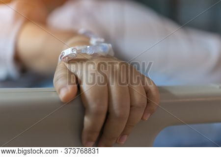 Virus Treatment Of Patients Saline, Iv Drip, Young Woman Hand With Medical Drip Intravenous Needle O