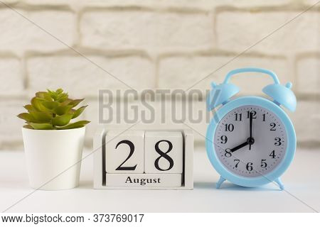 August 28 On A Wooden Calendar Next To The Alarm Clock. Summer Day, Empty Space For Text.calendar Fo