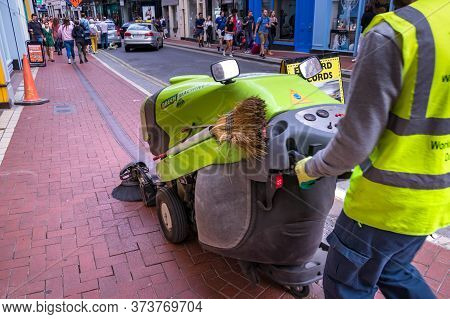 Dublin, Ireland - July 28, 2019: A Male Worker Cleaning The Streets With A Sweeping Machine In Dubli