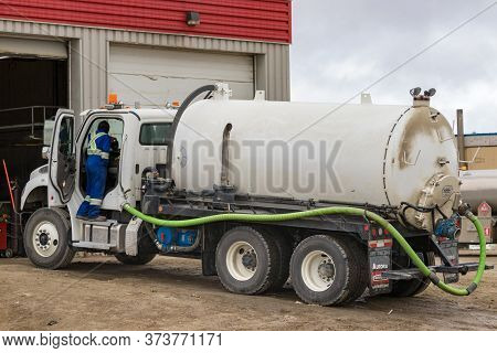 Clyde River, Baffin Island, Canada - August 20th, 2019: A Tanker Truck With The Driver On The Door P