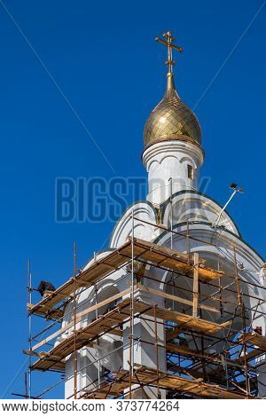 Petropavlovsk, Russia - September 15, 2019: Constructors On Scaffolds Building The Maritime Cathedra