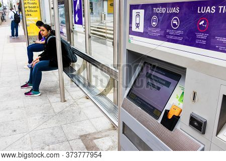 Dublin, Ireland - July 29th, 2019: The Tram Luas Ticket Machine At A Station In Dublin, Ireland.