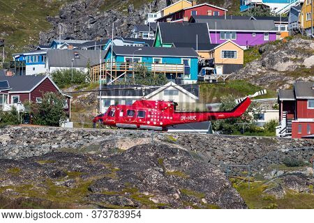Qaqortoq, Greenland - August 14, 2019: An Helicopter Of Air Grenland Ready To Take Off At The Coastl