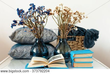 Cozy Home Interior Decor: Stack Of Books, Vase With Flowers On A White Table. Distance Home Educatio