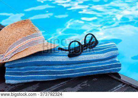 Vintage Summer Wicker Straw Beach Hat, Sun Glasses, Blue Towel Near Swimming Pool, Tropical Backgrou