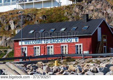 Qaqortoq, Greenland - August 14, 2019: The Welcome Board On A Tours Office In Qaqortoq, Greenland.