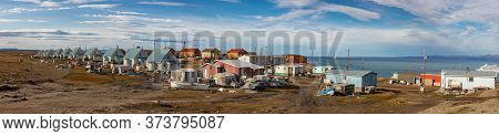 Pond Inlet, Baffin Island, Canada - August 23, 2019: Panorama Of Residential Wooden Houses On A Dirt