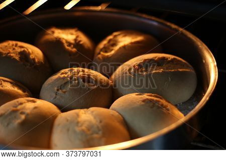 A Picture Of Several Small Pains Taken Out Of The Oven