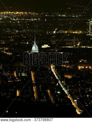 Night View Of The City Of Turin In Piedmont With The Mole Antonelliana Illuminated At Night