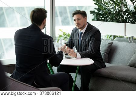 Two Business Men Meeting Or Job Interview, Businessmen Discussing Deal