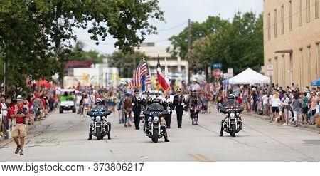 Arlington, Texas, Usa - July 4, 2019: Arlington 4th Of July Parade, Trio Of Police Motorcycles Leadi