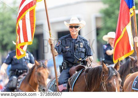 Arlington, Texas, Usa - July 4, 2019: Arlington 4th Of July Parade, Mounted Police Officer, Carrying