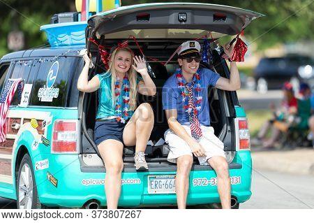 Arlington, Texas, Usa - July 4, 2019: Arlington 4th Of July Parade, Woman And Man Riding On A Van, P