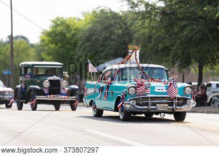 Arlington, Texas, Usa - July 4, 2019: Arlington 4th Of July Parade, A Chevrolet Bel Air, With Americ