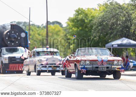 Arlington, Texas, Usa - July 4, 2019: Arlington 4th Of July Parade, A Chevrolet Chevelle, With Ameri