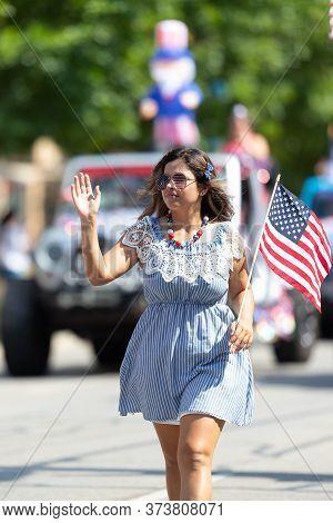 Arlington, Texas, Usa - July 4, 2019: Arlington 4th Of July Parade, Woman Walking Down Center Street