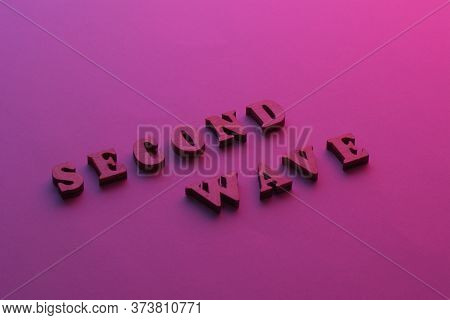 Text Second Wave Covid19 On Purple Background. 2nd Wave Of Coronavirus Is Coming. Concept Of The Sec