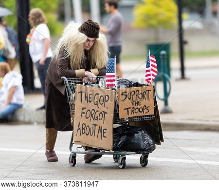 Cincinnati, Ohio, Usa - June 22, 2019: The Cincinnati Pride Parade, Woman Dress Up As A Homeless Per