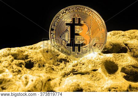 Closeup Of Bitcoin Digital Currency And Gold Nugget Or Gold Ore On Black Background, Precious Stone