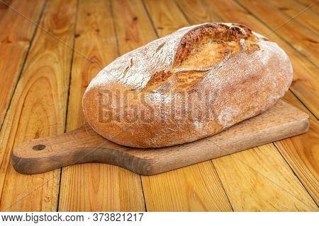 Tasty Fresh Bread On A Wooden Table. Bread In The Home Kitchen.