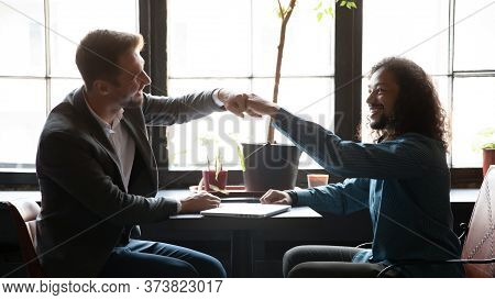 Multi Ethnic Buddies Greeting Each Other With Fists Bumping Gesture