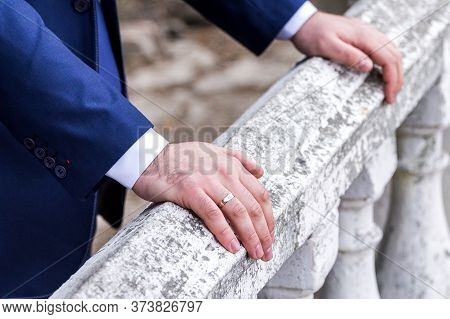 The Groom Holds His Hands On The Railing. Vintage Railing. Wedding. Just Got Married.