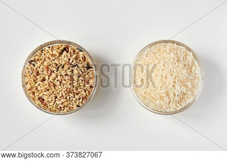 Raw Brown Rice And White Rice In A Transparent Glass Plate On White Background. Problem Of Choice. C