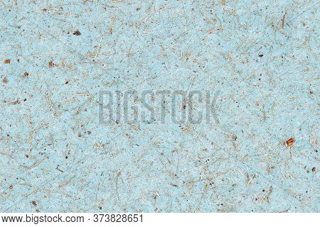 Blue Paper Cardboard With A Rough Coarse Texture And Wood Chips. Abstract Background.