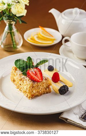 Traditional Napoleon Puff Cake With Vanilla Custard And Berries, Garnished With Strawberries And Min