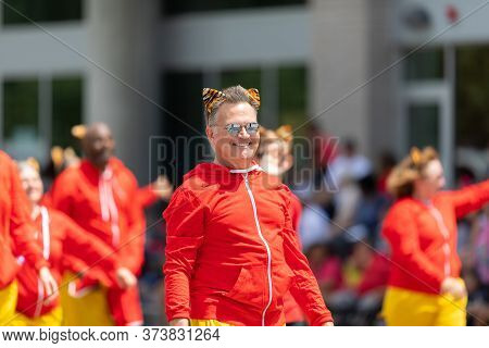 Indianapolis, Indiana, Usa - May 25, 2019: Indy 500 Parade, Dancers Wearing Tiger Ears Going Down Pe