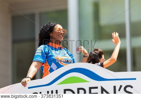 Indianapolis, Indiana, Usa - May 25, 2019: Indy 500 Parade, Woman Wearing A Hotwheels Shirt, Promoti