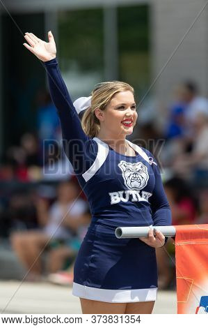 Indianapolis, Indiana, Usa - May 25, 2019: Indy 500 Parade, Lady From The Butler University Waving A