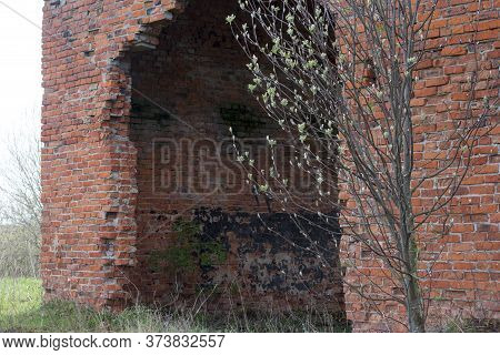 An Old Abandoned Collapsed Brick Building. After The Earthquake, The Wear And Tear Of The House.