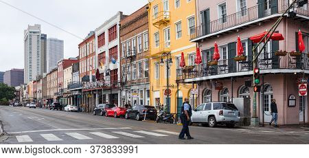 New Orleans, Louisiana, Usa - November 30, 2019: People Walking Along The Old Buildings Of The Frenc