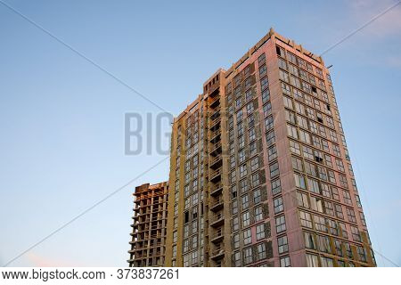 Mineral Wool Insulation Of The Facade Building On Construction Site. Thermal Protection Of The House