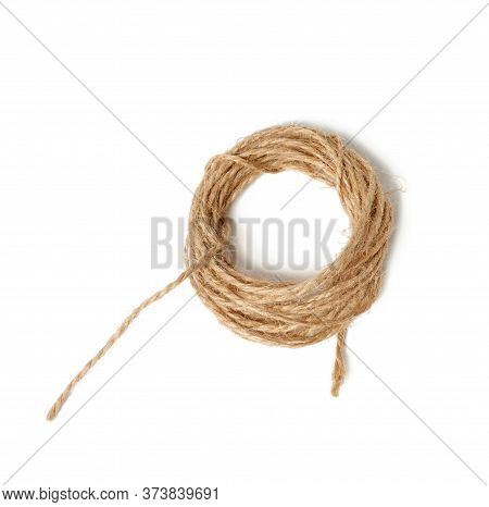 Brown Folded Twine Isolated On A White Background, Rope For Household Needs