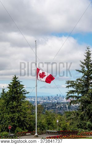 Canadian Flag Flying At Half-mast.     Vancouver Bc Canada