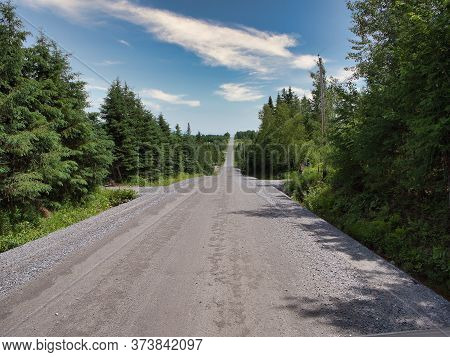 An Empty Long Rural Slope Mountain Road