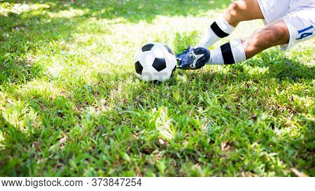 Soccer Player Control To Shoot Ball On Green Grass To Goal. Soccer Player Training For Match.
