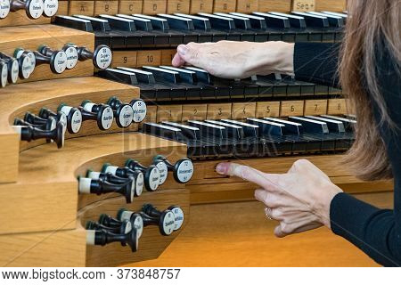 Close-up Of Female Hands Playing A Pipe Organ.