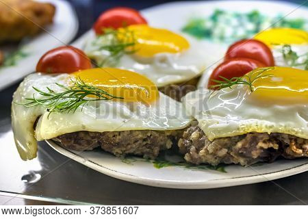 Close Up Of A Plate With Minced Meat And Rice Hamburgers With A Fried Egg On Top In Petropavlovsk, R