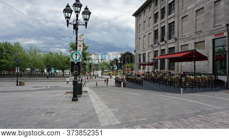 Montreal, Qc/ Canada - 6/25/2020: Place Jacques-cartier - People Enjoy Their Time At A Restaurant Af